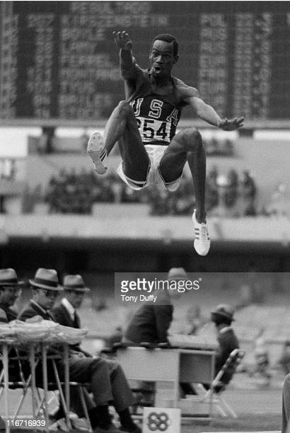 Bob Beamon of the United States leaps 29 feet 2½ inches 890m to win gold and set an Olympic record during the Men's Long Jump event at the XIX Summer...