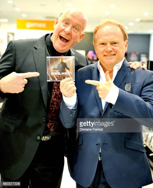 Bob Blakeley and Mike Batt pose before performing and signing copies of Bob's debut album 'Performance' at HMV Manchester on May 19 2014 in...