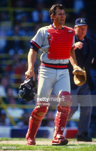 Bob Boone of the California Angels catches against the Chicago White Sox during an MLB game at Comiskey Park in Chicago Illinois Boone played for the...