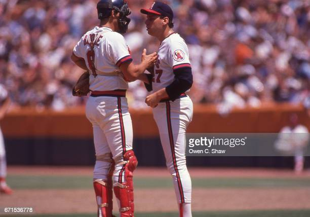 ANAHEIM CA Bob Boone of the California angels confers with Willie Fraser circa 1986 with the California Angels at the Big A in Anahiem California
