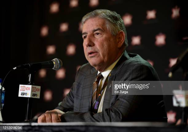 Bob Bowlsby commissioner of the Big 12 talks to the media as he announces that the Big 12 basketball tournament has been cancelled due to growing...