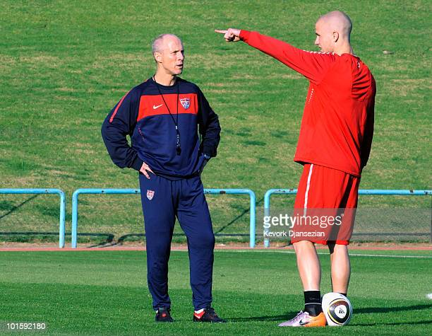 Bob Bradley head coach of US national soccer team talks with his son Michael Bradley during training session on June 3 2010 in Pretoria South Africa...