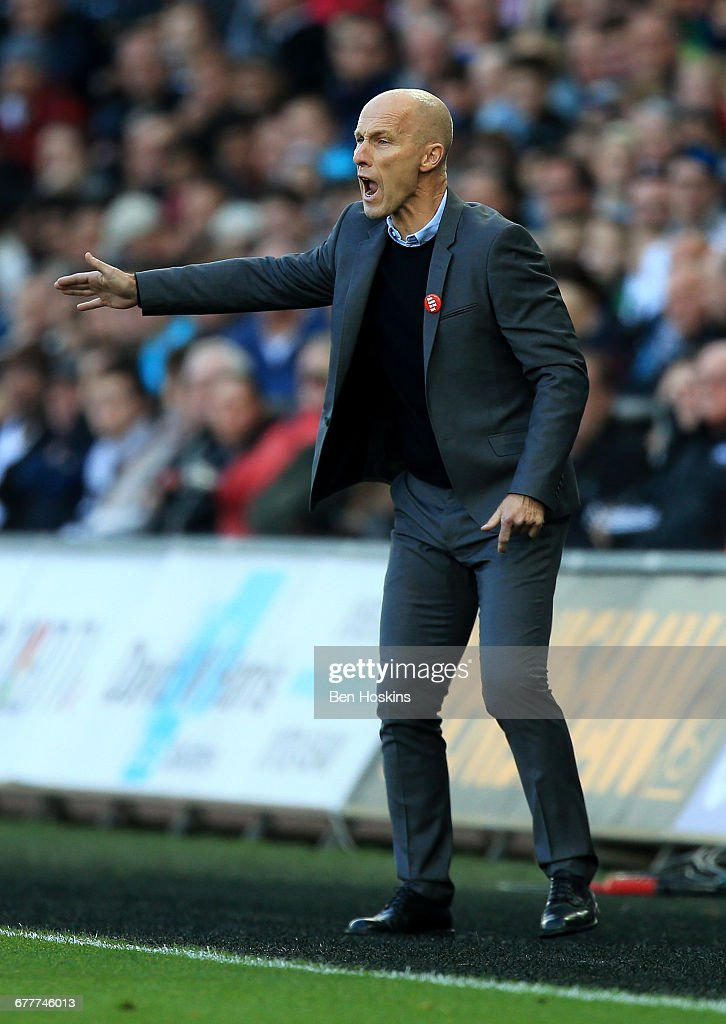 Bob Bradley, Manager of Swansea City gives team instructions during the Premier League match between Swansea City and Watford at the Liberty Stadium on October 22, 2016 in Swansea, Wales.
