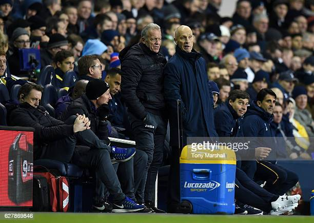Bob Bradley, Manager of Swansea City talks to Alan Curtis, 1st team coach of Swansea City during the Premier League match between Tottenham Hotspur...