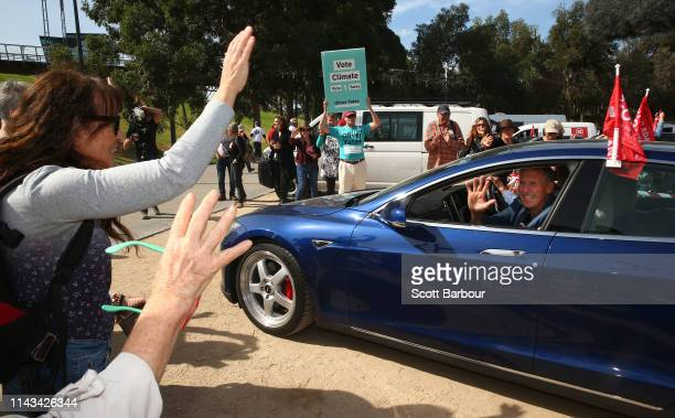 Bob Brown environmentalist and former leader of the Australian Greens gestures to supporters as he leaves in an electric vehicle as part of the 'Stop...