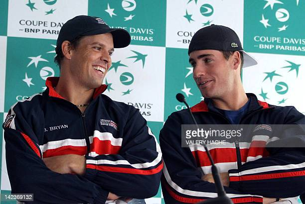 US Bob Bryan and John Isner give a press conference on April 3 2012 in Monaco ahead of the France vs USA Davis Cup quarter final tennis match The...