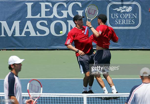 Bob Bryan and Mike Bryan bump chests in celebration after defeating Paul Hanley of Australia and Kevin Ullyett of Zimbabwe 63 57 103 to win the...
