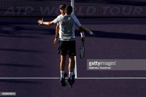 Bob Bryan and Mike Bryan celebrate match point against JanLeonard Struff of Germany and Ben McClachlan of Japan during the doubles semifinals of the...
