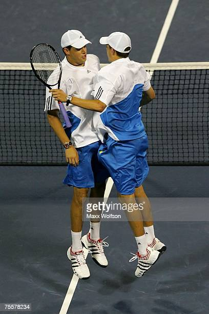 Bob Bryan and Mike Bryan chest bump after defeating Amer Delic and Igor Kunitsyn of Russia during the quarterfinals of the Countrywide Classic on...