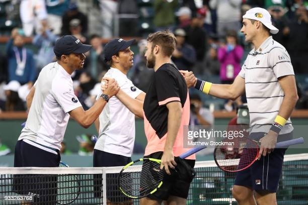 Bob Bryan and Mike Bryan congratulate Jack Sock and John Isner after their match during the men's doubles final on Day 13 of the BNP Paribas Open at...