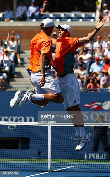 Bob Bryan and Mike Bryan of the United States celebrate match point with a chest bump against Leander Paes of India and Radek Stepanek of the Czech...