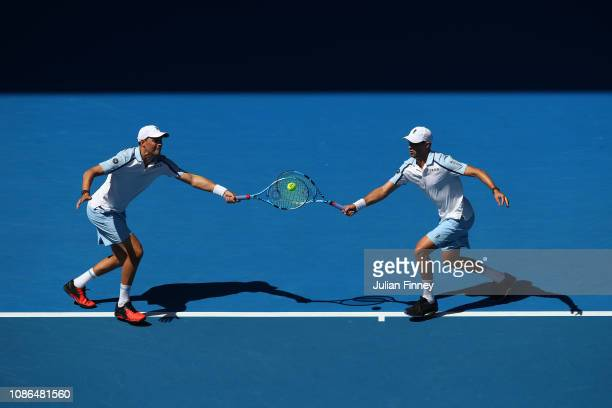 Bob Bryan and Mike Bryan of the United States compete in their doubles match against PierreHugues Herbert and Bicolas Mahut of France during day 10...