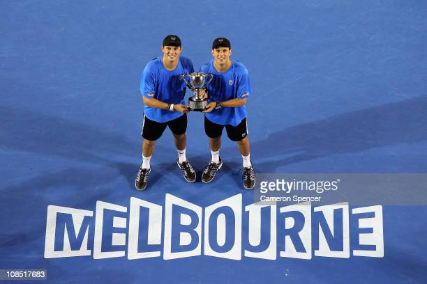 Bob Bryan and Mike Bryan of the United States of America pose with the trophy after winning their men's doubles final match against Mahesh Bhupathi...