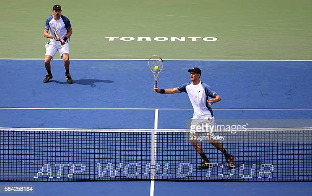 Bob Bryan and Mike Bryan of the USA celebrate play a shot against Marcin Matkowski of Poland and Max Mirnyi of Belarus during Day 4 of the Rogers Cup...