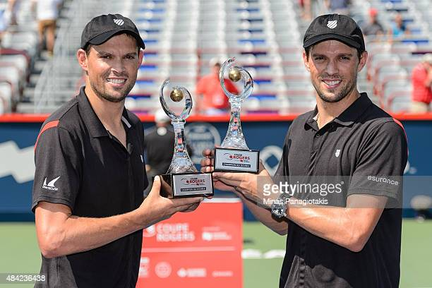 Bob Bryan and Mike Bryan of the USA hold up their Rogers Cup Doubles Championship trophies after defeating Daniel Nestor of Canada and Edouard...