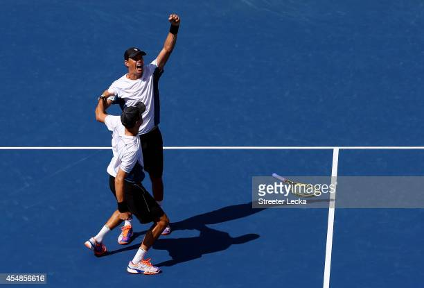 Bob Bryan and Mike Bryan of United States celebrate after defeating Marcel Granollers and Marc Lopez of Spain in their men's doubles final match on...