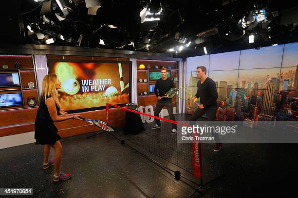 Bob Bryan and Mike Bryan of United States play tennis with Stephanie Abrams on the Weather Channel set during their New York City media tour after...