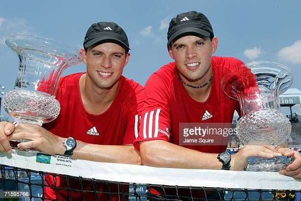 Bob Bryan and Mike Bryan pose with their trophies after defeating Paul Hanley of Australia and Kevin Ullyett of Zimbabwe 6-3, 5-7, 10-3 to win the...