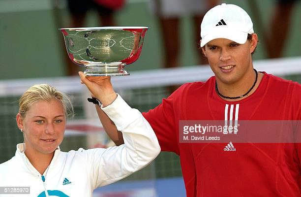 Bob Bryan and Vera Zvonareva hold the trophy after winning the mixed doubles final against Alicia Molik and Todd Woodbridge during the US Open...