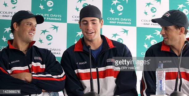 US Bob Bryan John Isner and Mike Bryan give a press conference on April 3 2012 in Monaco ahead of the France vs USA Davis Cup quarter final tennis...