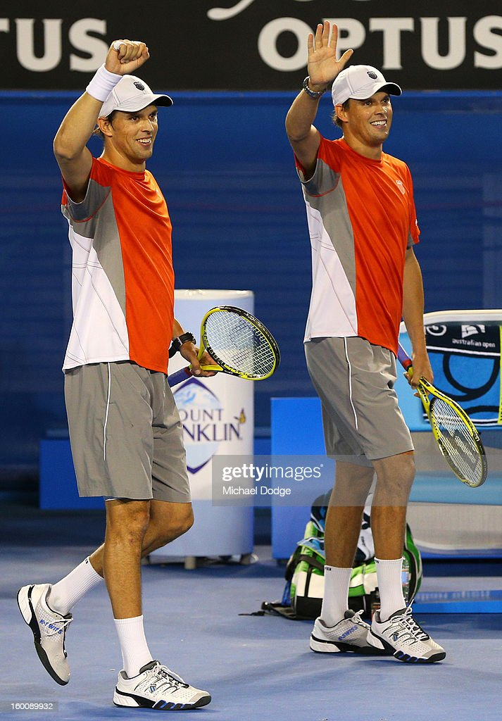 Bob Bryan of the United States and Mike Bryan of the United States celebrates winning their doubles final match against Robin Haase of the Netherlands and Igor Sijsling of the Netherlands during day thirteen of the 2013 Australian Open at Melbourne Park on January 26, 2013 in Melbourne, Australia.