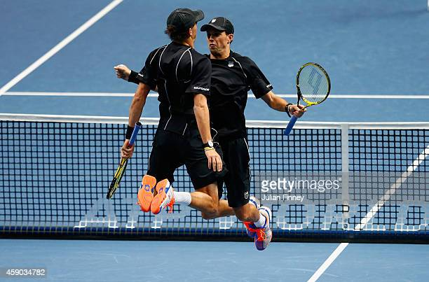 Bob Bryan of the United States and Mike Bryan of the United States celebrate match point in the doubles semifinal match against Julien Benneteau of...