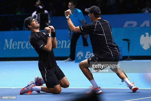 Bob Bryan of the United States and Mike Bryan of the United States celebrate match point in the doubles final match against Ivan Dodig of Croatia and...