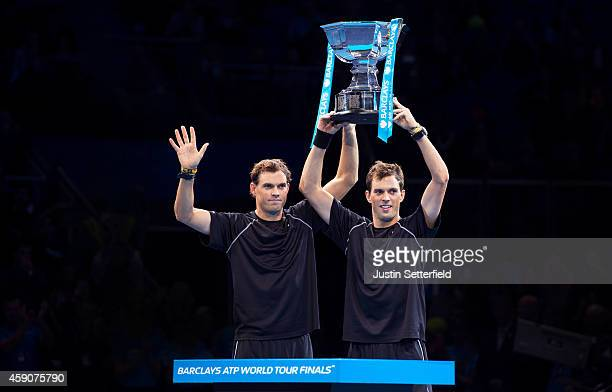 Bob Bryan of the United States and Mike Bryan of the United States lift the ATP Doubles Trophy after the doubles final match against Ivan Dodig of...