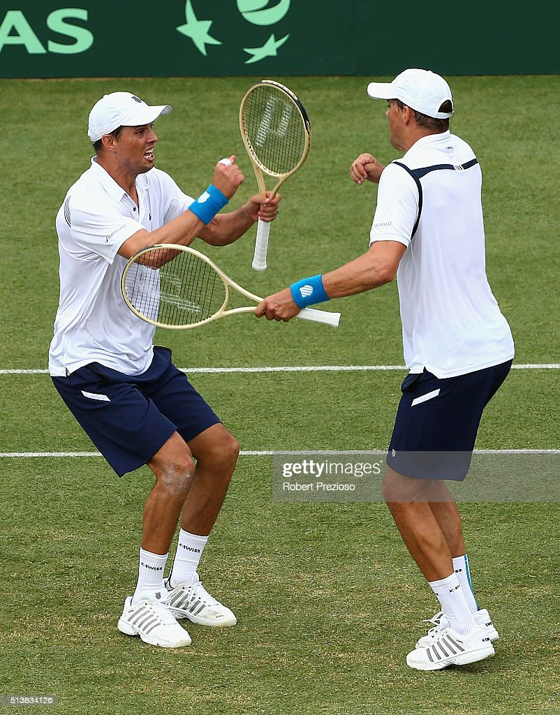 Bob Bryan of the United States and Mike Bryan of the United States celebrate winning the Men's doubles match against Lleyton Hewitt of Australia and John Peers of Australia during the Davis Cup tie between Australia and the United States at Kooyong on March 5, 2016 in Melbourne, Australia.
