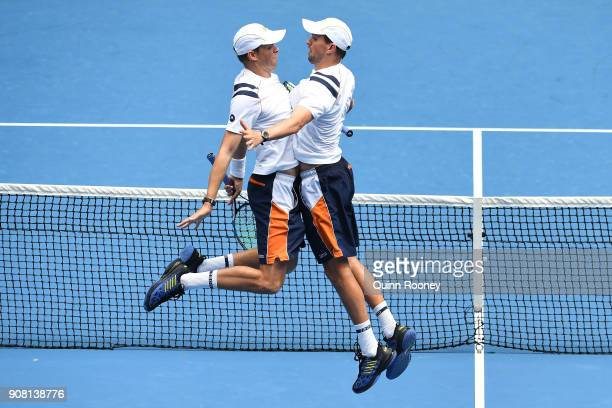 Bob Bryan of the United States and Mike Bryan of the United States celebrate in their third round match against Jeremy Chardy of France and Fabrice...