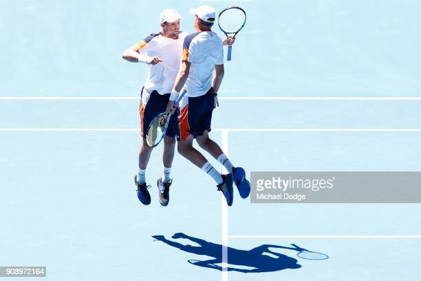 Bob Bryan of the United States and Mike Bryan of the United States celebrate winning match point in their legend's doubles match against AisamUlHaq...