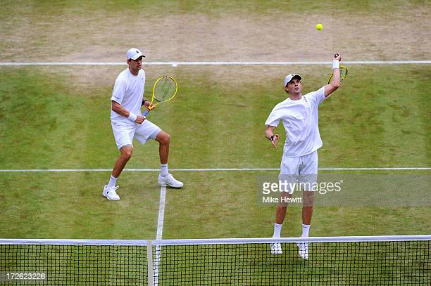 Bob Bryan of the United States of America smashes the ball next to teammate Mike Bryan during the Gentlemen's Doubles semi final match against Rohan...