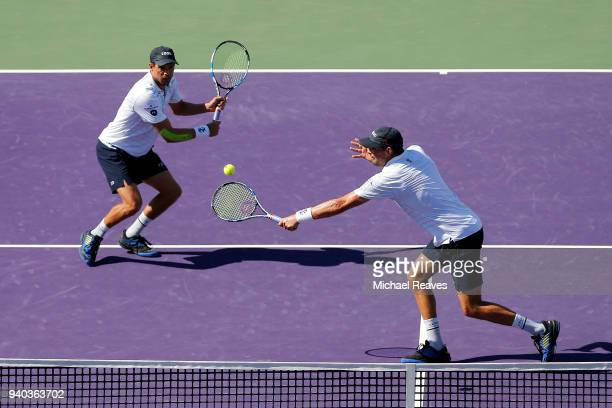 Bob Bryan of the United States returns a shot against Karen Khachanov and Andrey Rublev of Russia while playing with Mike Bryan of the United States...