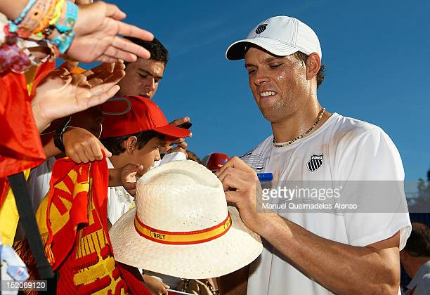 Bob Bryan of the United States signs autographs for fans after day two of the semi final Davis Cup between Spain and the United States at the Parque...