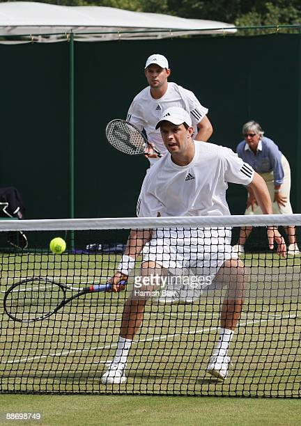 Bob Bryan of USA plays a forehand playing with Mike Bryan of USA during the men's doubles second round match against Johan Brunstrom of Sweden and...