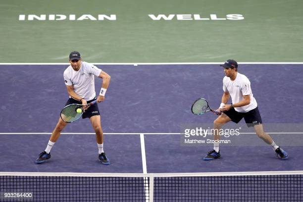 Bob Bryan returns a shot to John Isner and Jack Sock while playing with Mike Bryan during the men's doubles final on Day 13 of the BNP Paribas Open...