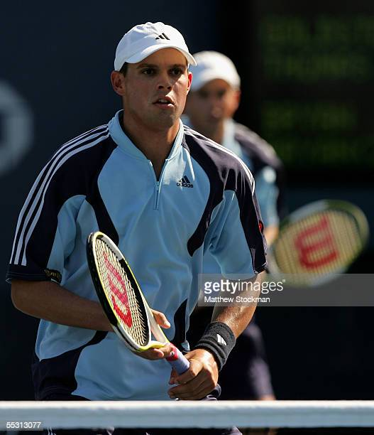 Bob Bryan waits at the net in front of his doubles partner Mike Bryan during their semifinal match against Paul Goldstein and Jim Thomas as the US...