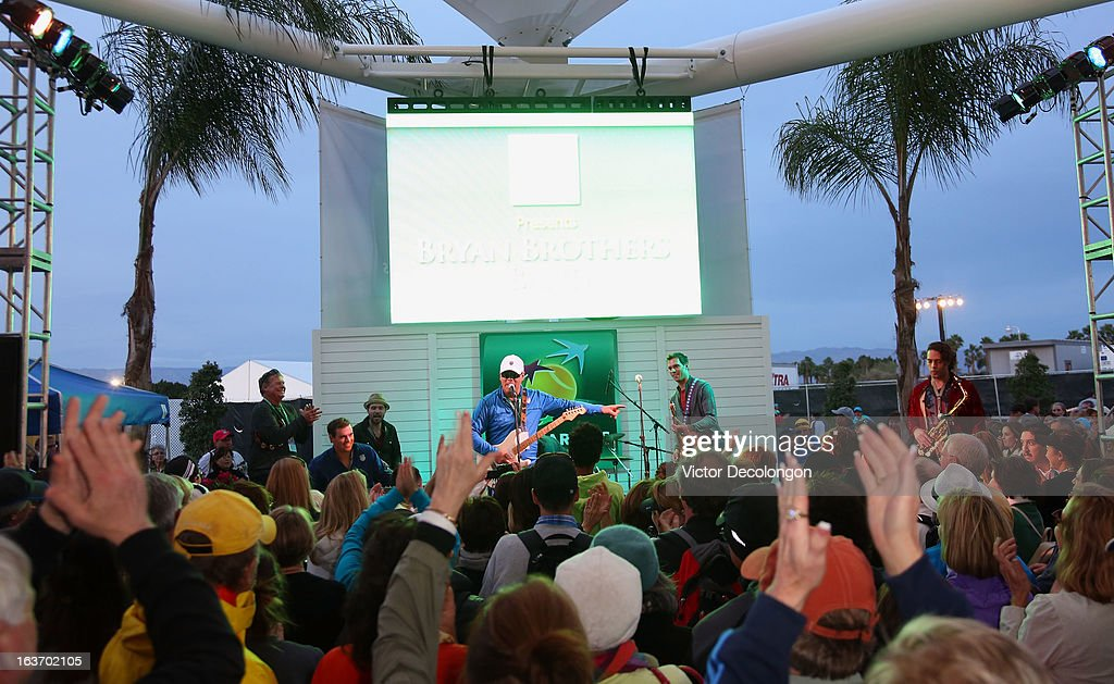 Bob Bryan (keyboards), Wayne Bryan (mic) and Mike Bryan (guitar) onstage during a concert at Indian Wells Tennis Garden on March 7, 2013 in Indian Wells, California.