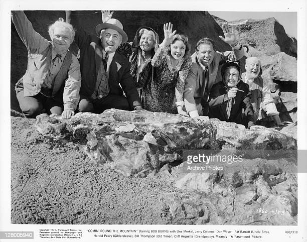 Bob Burns Una Merkel Jerry Colonna Don Wilson Pat Barrett Harold Peary Bill Thompson and Cliff Arquette waiving from a mountain in a scene from the...