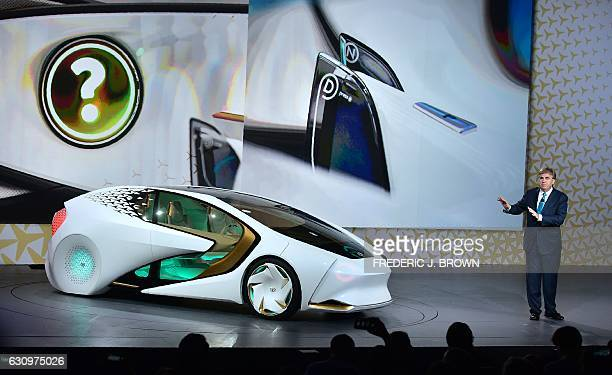 Bob Carter Senior VP Automotive Operations speaks at the Toyota press conference as the Toyota Concepti vehicle is revealed at the 2017 Consumer...