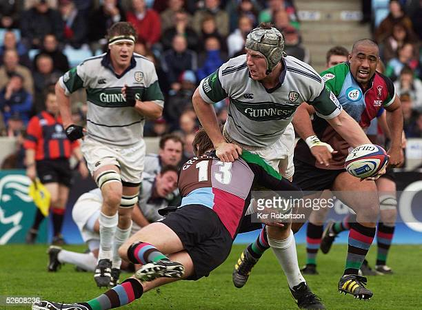 Bob Casey of London Irish is tackled by Will Greenwood of NEC Harlequins during the Zurich Premiership match between NEC Harlequins and London Irish...