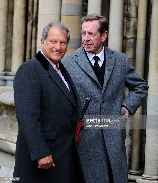 Bob Champion and Derek Thompson arrive at the Sir Henry Cecil memorial service at Ely Cathedral on September 16 2013 in Ely England