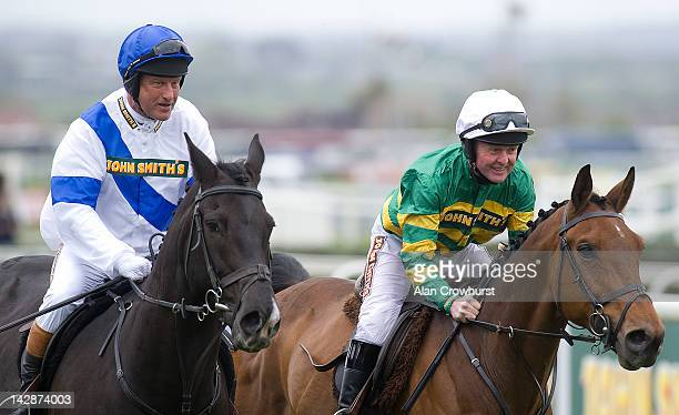 Bob Champion and Jonjo O'Neill at Aintree racecourse on April 14 2012 in Liverpool England