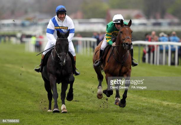 Bob Champion and Jonjo O'Neill lead out the horses for the John Smith's Aintree Legends Charity Race during day three of the 2012 John Smith's Grand...