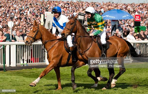 Bob Champion and Jonjo O'Neill parade before the crowd before John Smith's Aintree Legends Charity Race during Grand National Day at Aintree...