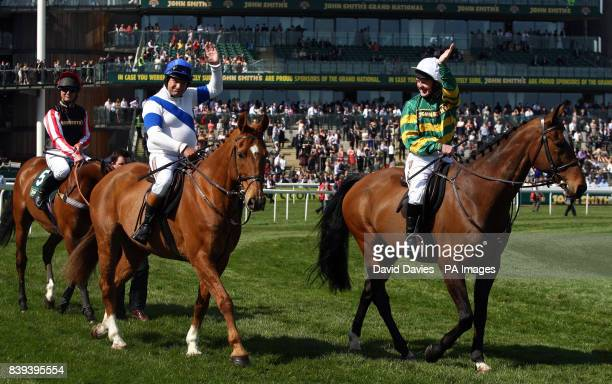 Bob Champion and JonJo O'Neill parade in front the grandstands before the Legends Race during Grand National Day at Aintree Racecourse Liverpool