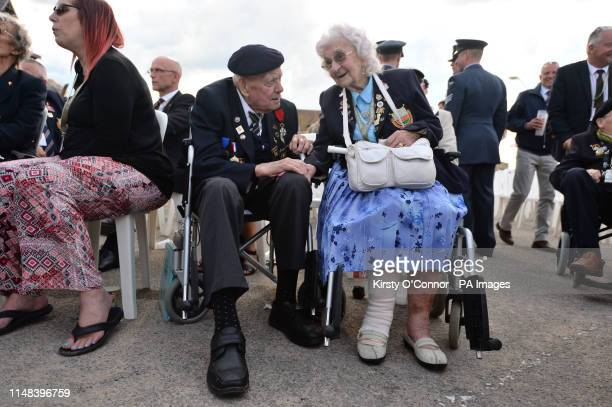 Bob Conway and Gwen Conway 90 chat on the promenade at Arromanches beach in Normandy northern France during commemorations for the 75th anniversary...