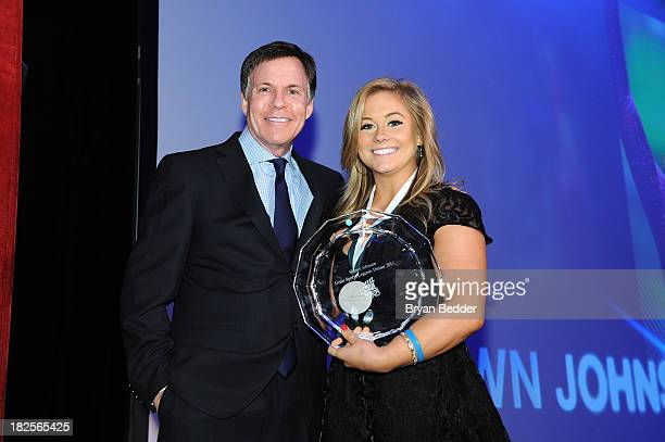 Bob Costas and Sports Legend and gymnast Shawn Johnson speak onstage at the 28th Annual Great Sports Legends Dinner to Benefit The Buoniconti Fund To...