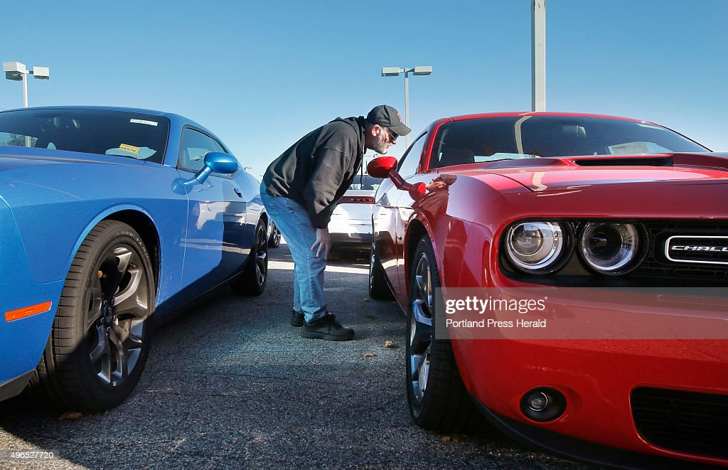 Bob Cournoyer Of Lewiston Looks Inside A Dodge Challenger At Lee