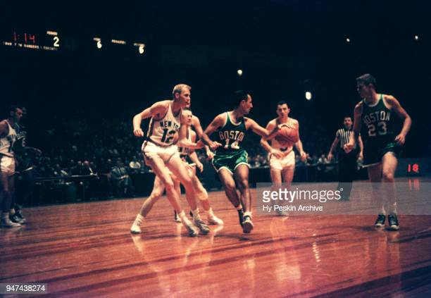 Bob Cousy of the Boston Celtics dribbles as Kenny Sears of the New York Knicks defends during an NBA game on October 25 1958 at the Madison Square...
